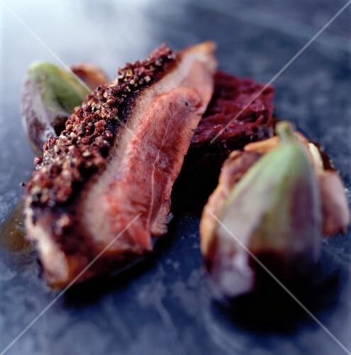 Smoked duck breast with a Szechuan pepper crust, fried figs and red cabbage timbale