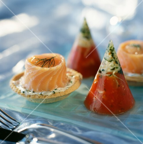 Salmon and dill tartlets and tomato and aspic cones