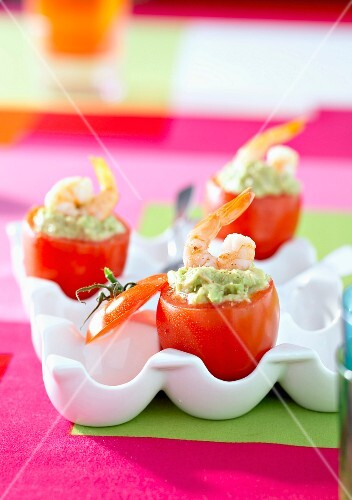 Tomatoes stuffed with guacamole and shrimps