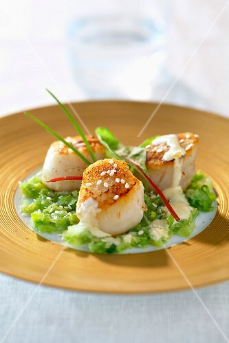Roasted scallops with mandarin butter and thinly chopped leeks