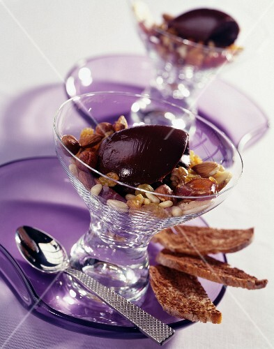 Chocolate Ganache quenelle with dried fruit and thinly sliced bread with cocoa