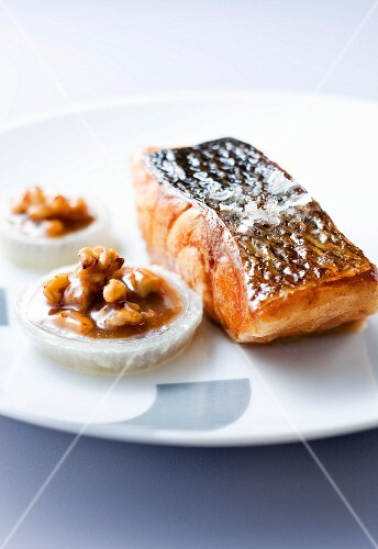 Thick piece of roast bass with walnut toffee