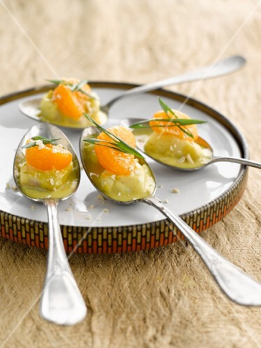 Spoonful of fish with clementines