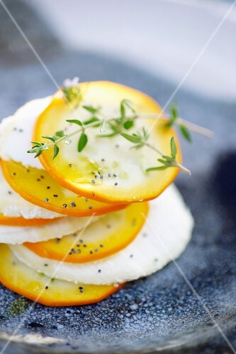 Yellow zucchini and goat's cheese Mille-feuille with poppy seeds