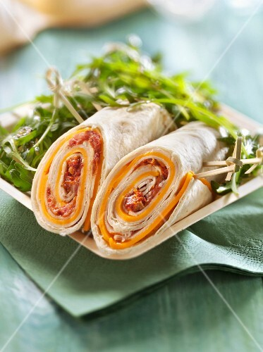 Preserved tomato and Edam wrap served with rocket lettuce