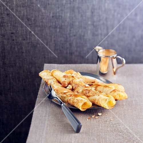 Rolled hazelnut crepes with toffee sauce