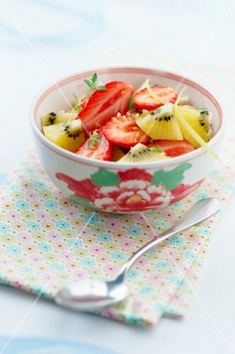 Strawberry and yellow kiwi fruit salad