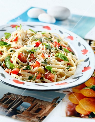 Linguini with fresh tomatoes,basil,almonds and parmesan