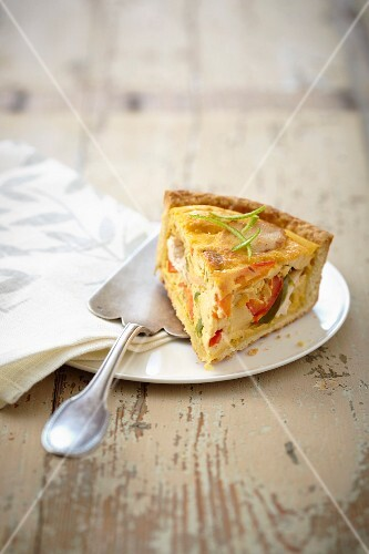 Slice of chicken and pepper savory tart