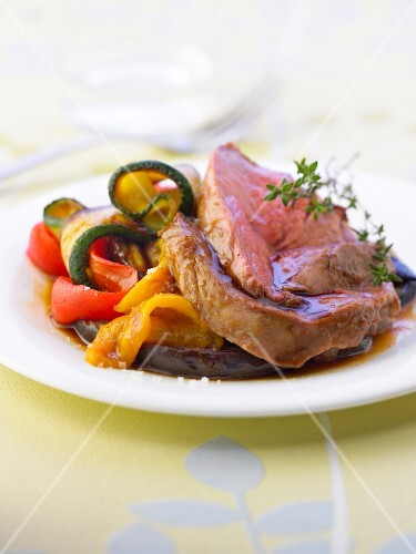 Sliced leg of lamb with southern vegetables