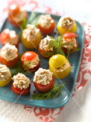 Chery tomatoes stuffed with three fish patés