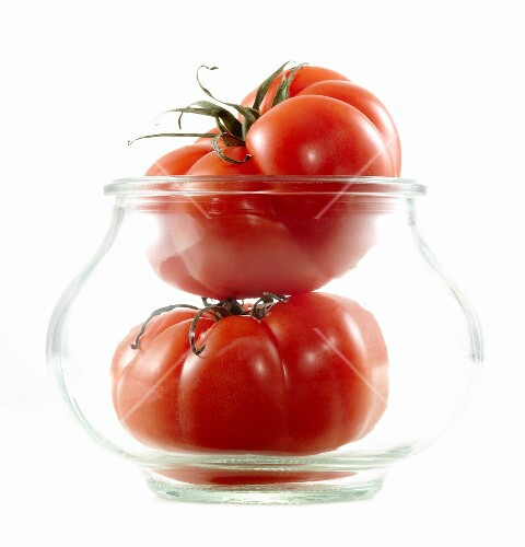 Two tomatoes in a jar