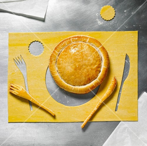 Flaky pastry pie and knife and fork