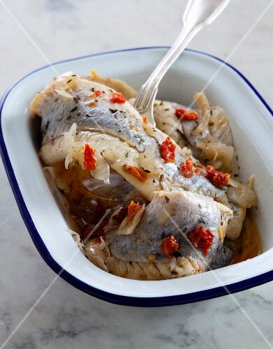 Marinated herring with chilli peppers