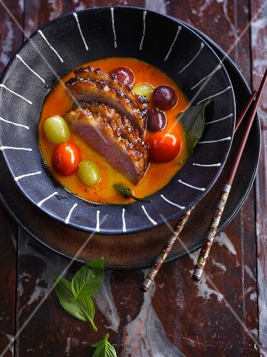 Roasted duck breast with grapes and curry sauce