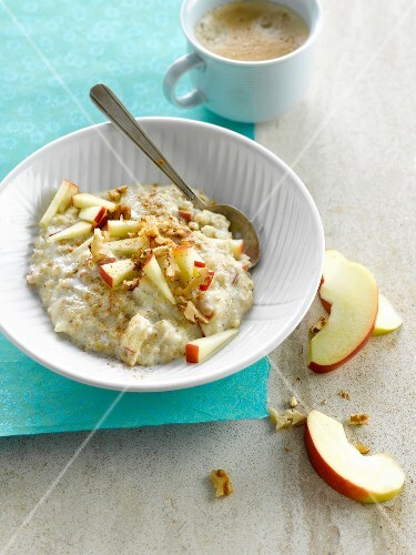 Porridge with sliced apple and crushed walnuts