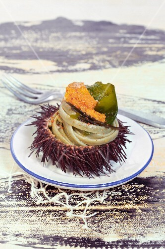 Pasta with urchin roe and seaweed served in an urchin