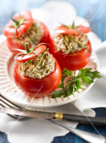 Tomatoes stuffed with potted sardines, cream cheese and herbs