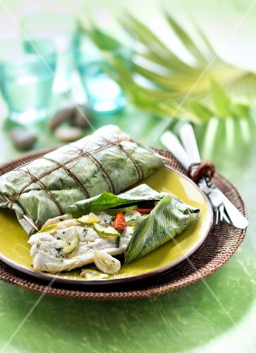 Peixe na folha de bananeira,sea bream marinated with garlic and lime cooked in a banana leaf