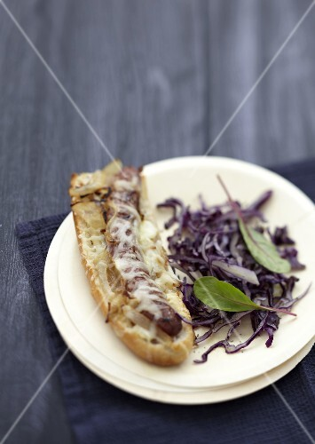 Chipolata and onion open sandwich grilled with Gruyere