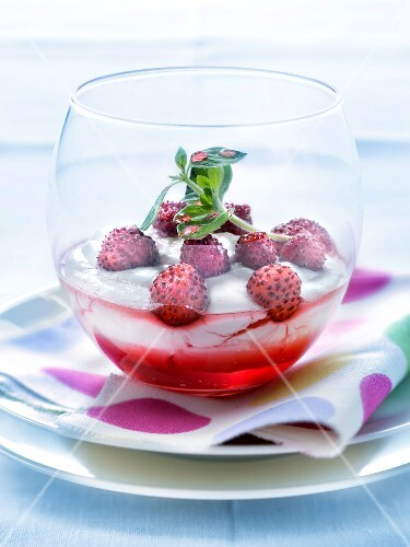 Fontainebleau with wild strawberries and pomegranate syrup