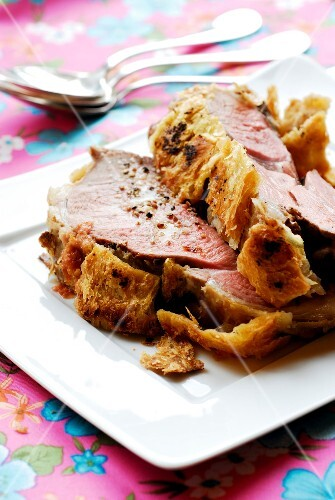 Carved leg of lamb in pastry crust
