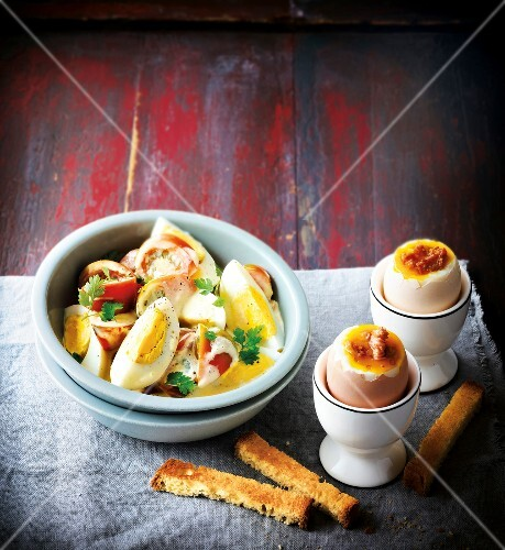 Soft-boiled eggs and tomato and hard-boiled egg salad
