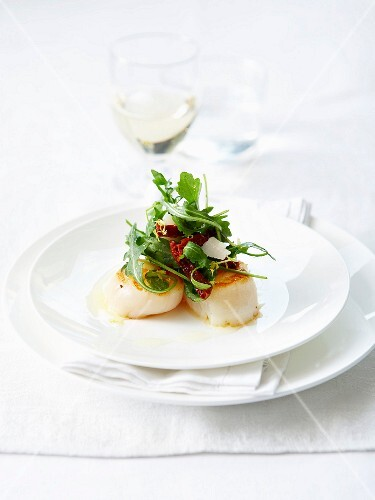 Roasted scallops in truffle oil and small fancy salad