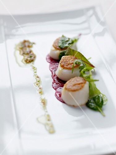 Crisp scallops on a bed of beetroot carpaccio,hazelnut oil and herbs