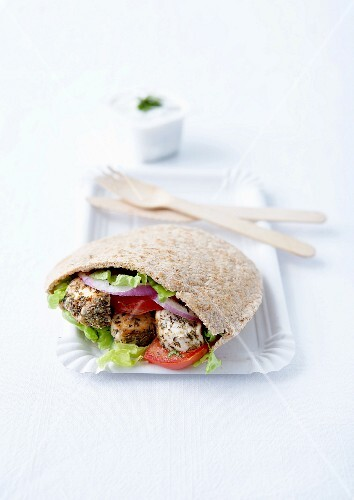 Marinated chicken, herb and vegetable pitta sandwich