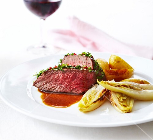 Roast beef with herbs and gravy,braised chicory