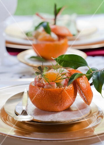 Surimi, shrimp and clementine salad served in a clementine