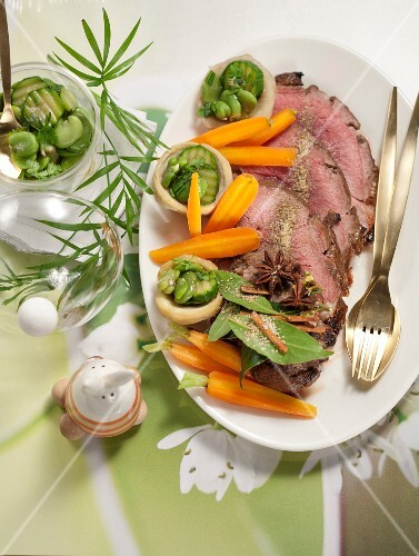 Roast leg of lamb with honey and spices served with steamed vegetables