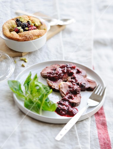 Lamb with stewed summer fruit,small summer fruit and pistachio moist cake