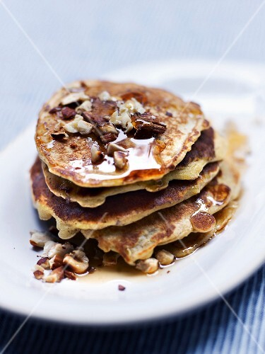 Small oat pancakes with grated apples, hazelnuts, almonds and cinnamon