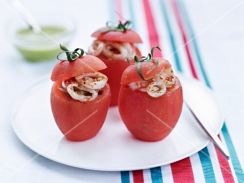 Peeled tomatoes with cuttlefish filling