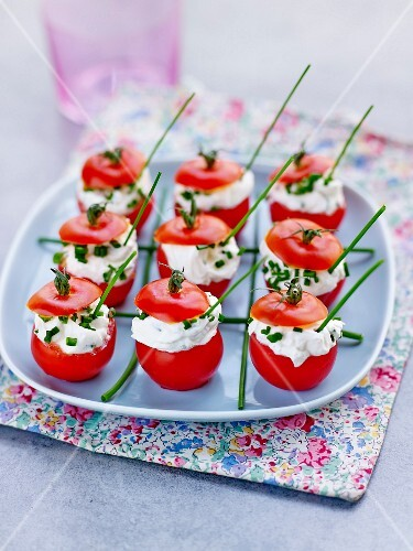Cherry tomatoes filled with cream cheese and chives