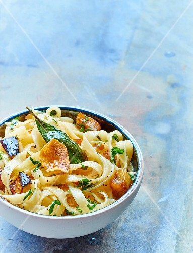 Tagliatelles with eggplants,onion,garlic and basil