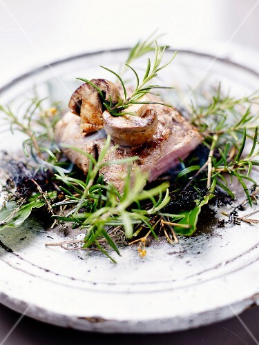 Veal smoked on a scrubland fire with mushrooms