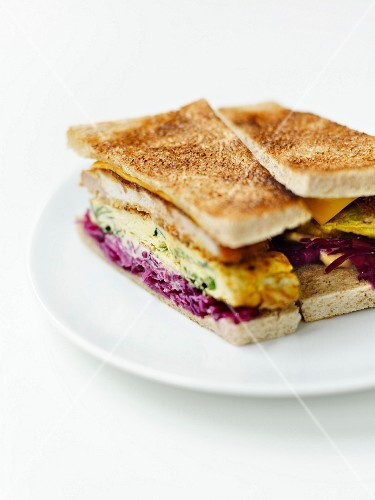 Tonkatsu breaded pork, stewed red cabbage, vegetable omelette and Worcestershire sauce sandwich