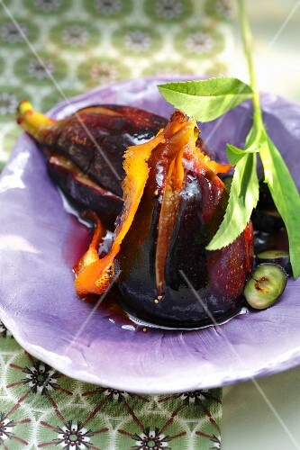 Stewed figs in orange rind and blueberry syrup
