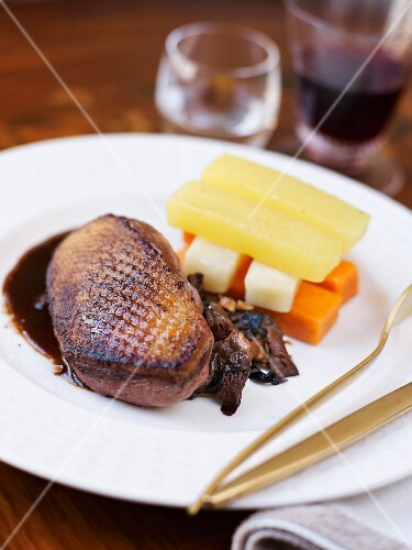 Roasted duck fillet with tender vegetables