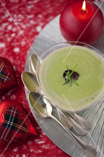 Cream of broad bean soup with chives and sliced truffle