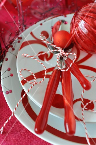 Red dishes,cutlery and table decorations