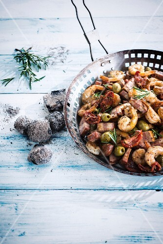 Pan-fried turkey bacon,olives,sun-dried and scampis with thyme