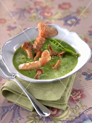 Chilled pea soup with langoustines and chanterelles