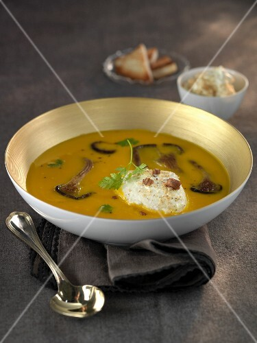 Cream of pumpkin soup with pleurotus mushrooms and hazelnut cream