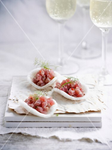 Asian crisps garnished with shrimps and tuna tartare