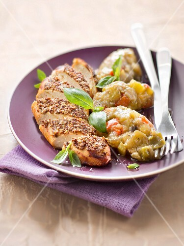 A grilled chicken escalope with coarse mustard and ratatouille confit