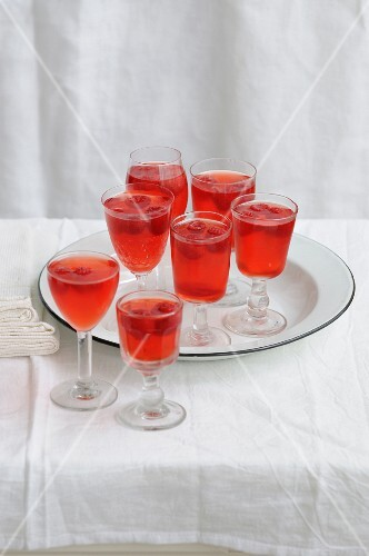 Glasses of raspberry juice